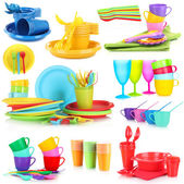 Bright plastic tableware isolated on  white — Stock Photo