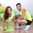 Stock Photo: Girl and trainer engaged in fitness room