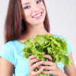 Beautiful girl with fresh salad on grey background — Stock Photo #41341859