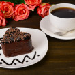 Sweet cake with chocolate on plate on table close-up — Stock Photo #41342807