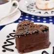 Sweet cakes with chocolate on plate on table close-up — Stock Photo #41342821