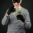 Thief isolated on black — Stock Photo #41343053