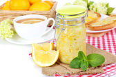 Tasty lemon jam with cup of tea on table close-up — Stock Photo