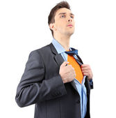 Young business man tearing apart his shirt revealing  superhero suit, isolated on white — Stock Photo