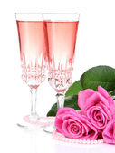 Composition with pink sparkle wine in glasses and pink roses isolated on white — Foto de Stock