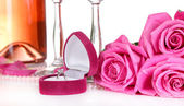 Composition with pink sparkle wine in glasses, bottle and pink roses isolated on white — Stockfoto