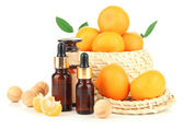 Tangerine essential oil and tangerines, isolated on white  — Stockfoto