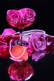 Composition with pink sparkle wine and  roses in glass, isolated on black — Fotografia Stock