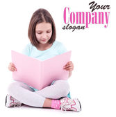 Beautiful little girl with book, isolated on white — Stock Photo