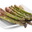 Delicious fresh asparagus on plate isolated on white — Stock Photo #41511581