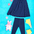Beautiful clothes for little girl on blue background — Stock Photo #41512257