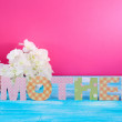 Mother- lettering of handmade paper letters on pink background — Stock Photo #41514891