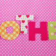 Mother- lettering of handmade paper letters on pink polkbackground — Stock Photo #41514973