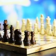 Stock Photo: Chess pieces on board on bright background