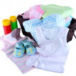 Stock Photo: Pile of baby clothes isolated on white