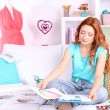 Young girl fashion designer draws new sketches collection — Stock Photo #41518241