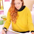 Young woman graphic designer working using pen tablet in workplace — Stockfoto