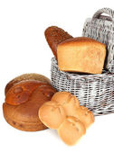 Composition with bread and rolls in wicker basket isolated on white — Stock Photo