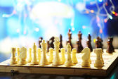 Chess pieces on board on bright background  — ストック写真