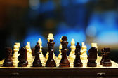 Chess pieces on board on bright background  — 图库照片