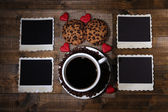 Coffee cup, cookies and old blank photos, on wooden background — Stockfoto