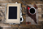 Composition with coffee cup and photo album, on wooden background — Stock fotografie