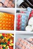 Medical pills, ampules in wooden box, close-up — Stockfoto