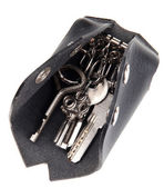 Black leather key case isolated on white — ストック写真