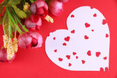 Paper heart with flowers on red background — Stock fotografie