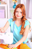 Young girl fashion designer sews new dress in workroom — Stock Photo