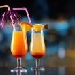 Glasses of tasty cocktails on bright background — Stock Photo #41549671