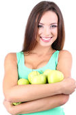 Beautiful young woman with green apples isolated on white — Stock Photo