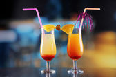 Glasses of tasty cocktails on bright background — Foto Stock