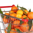 Ripe tasty tangerines in shopping cart isolated on white — Stock Photo #41586159