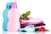 Detergent with washing powder and pile of colorful clothes isolated on white — Stock Photo