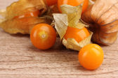 Physalis heap on wooden background — Stock Photo