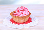 Tasty cake on table on light background — Stockfoto