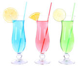 Glasses of cocktails isolated on white — Stock Photo