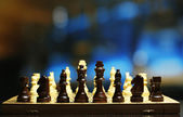 Chess pieces on board on bright background  — Foto de Stock
