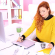 Young woman graphic designer working using pen tablet in workplace — 图库照片