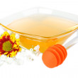 Stock Photo: Sweet honey in glass bowl isolated on white