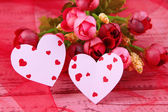 Paper hearts with flowers on table close up — Stock fotografie