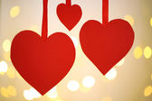 Paper hearts on bright background — Stockfoto