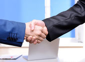 Business partners joining their hands — Stock Photo