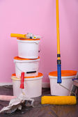 Buckets with paint and ladder on wall background. Conceptual photo of repairing works in  room  — Stockfoto