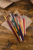 Brushes on wooden background  — Stock Photo