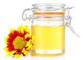 Sweet honey in glass jar isolated on white — Stock Photo