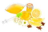 сладкий мед с лимоном, изолированные на белом — Стоковое фото
