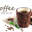 Stock Photo: Cup of coffee beans isolated on white