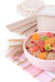 Delicious oatmeal with fruit in bowl on table close-up — Stock Photo